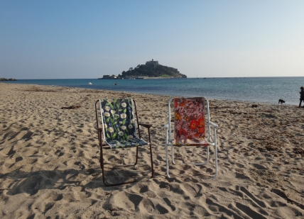 Deck chairs on the beach at Marazion